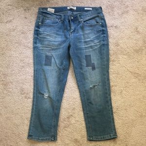 cropped ripped and patched jeans